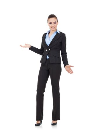 full length picture of an appealing young business woman looking undecided and confused at the camera, isolated on white photo