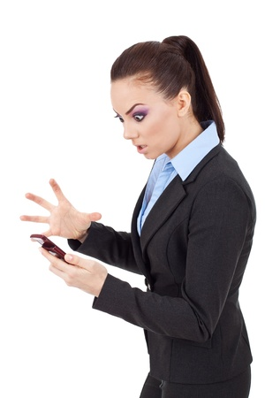 young attractive business woman angry on her phone on white background photo