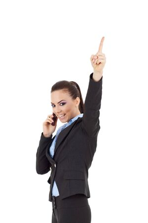 young business woman speaking on mobile phone and finger pointing up to empty copy space, isolated on white background photo