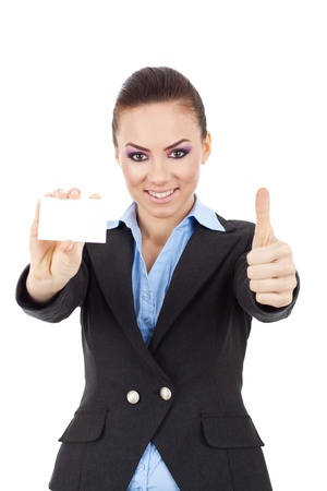 Portrait of young pretty business woman holding blank business card giving thumbs up isolated on white background  photo