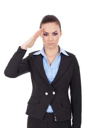 pledge: portrait of a young business woman saluting while looking in the camera on white background Stock Photo