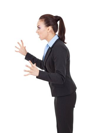 tense: side view of a fierce business woman scaring someone Stock Photo