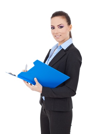 taking notes: Portrait of a happy young business woman taking notes and looking at the camera isolated over white background