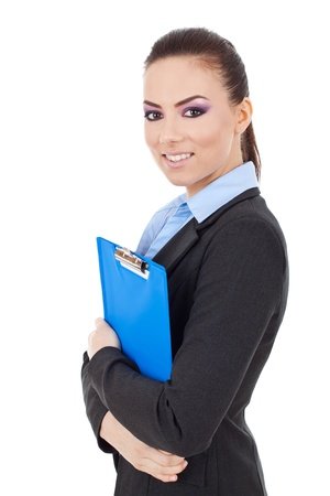 Portrait of a business woman holding a clipboard and smiling, isolated on white background  Stock Photo - 15738226