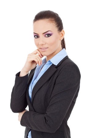 young business woman posing with hand on chin, acting thoughtful, looking at the camera,on white background photo