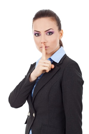 shut: Portrait of young serious business woman keeping finger on her lips and asking to keep quiet, isolated on white background  Stock Photo