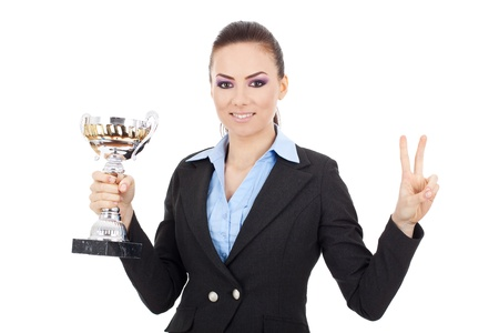 Happy young business woman holding a trophy and making a victory gesture, over white background Stock Photo - 15738177