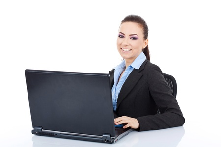 3g: Young business woman writing on a laptop and looking at the camera with a big smile on her face. on white background