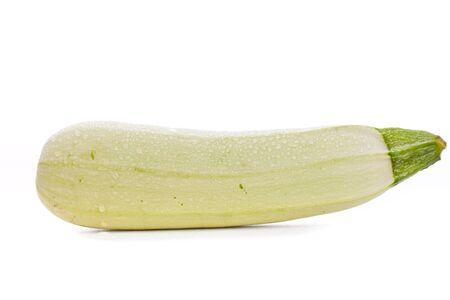 cucurbita: light green turkish zucchini (Cucurbita pepo) sprinkled with water on a white background