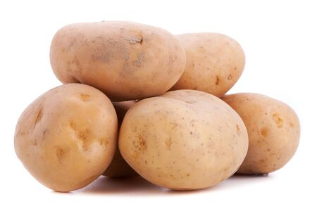 close up of a group of whole potatos on white background photo