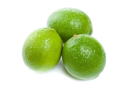 Group of three limes with water drops on them Stock Photo - 15736743