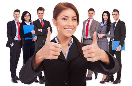 young business woman, leader of her team, making the ok thumbs up gesture Stock Photo - 15849520