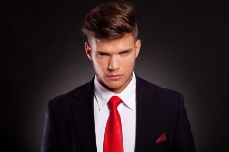 closeup portrait of a young business man looking threateningly into the camera photo