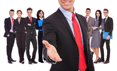 Isolated successful business team, focus on man with handshake gesture. young business man welcoming to the team with a handshake Stock Photo - 15849516