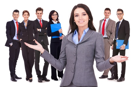 business woman leader welcoming to her successful team Stock Photo - 15849544