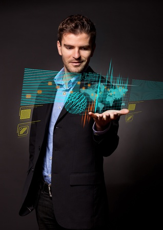 virtual technology: Business man in suit working and looking at  digital virtual screen  Stock Photo