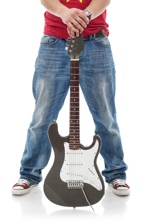 spread legs: cutuot picture of a casual man holding an electric guitar between his spread legs isolated over a white background