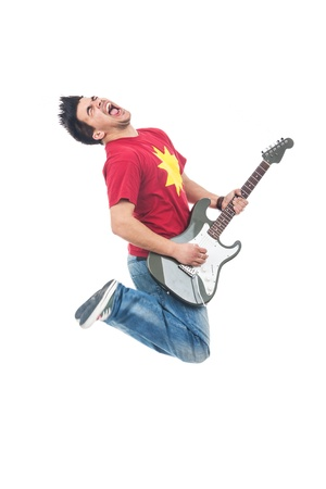 air guitar: young man jumping and shouting while playing his electric guitar