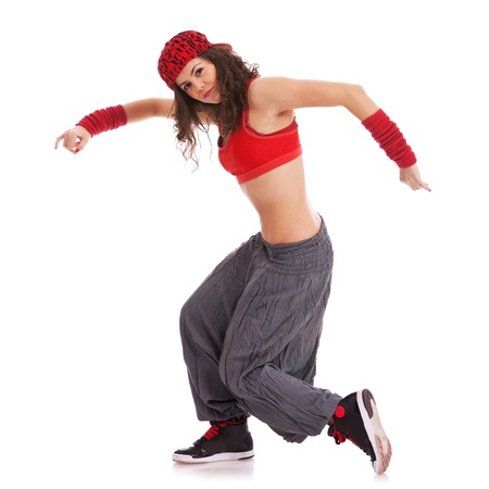 hip hop dancer: side view of a young modern woman dancer posing and looking into the camera