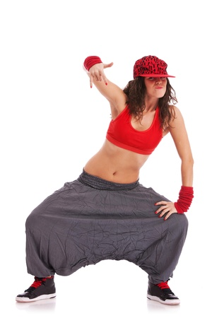 rnb: modern woman street dancer posing in a cool position showing rock sign