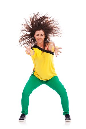 beautifull woman: beautifull woman dancer posing with hands extended towards camera and with hair in the wind. on white background