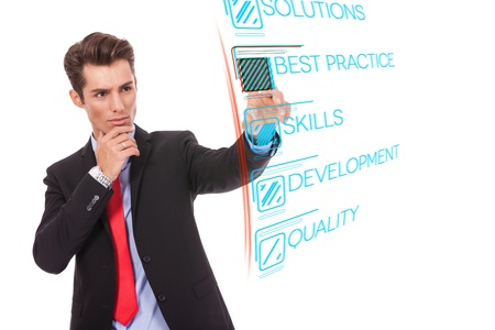 Young business man pushing Best Practice digital button, focus on finger and button photo