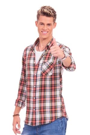 waistup: waist-up picture of a young casual man showing thumbs up on a white background