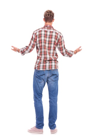 gesturing: back view of a young casual man welcoming someone, isolated on white background Stock Photo