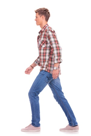 side by side: full length side view picture of a casual young man walking forward, isolated on white