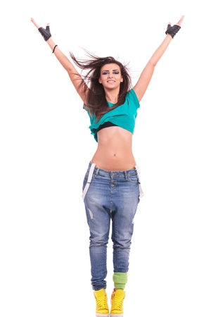 on tiptoes: beautiful young woman dancer posing with arms extended above her head, standing on tiptoes, in a Y position, on white background