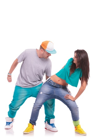 a pair of hip hop dancers performing on a white background photo
