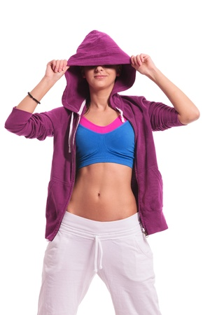 obscured face: cutout picture of a young woman dancer hiding her eyes with a hoodie and smiling Stock Photo