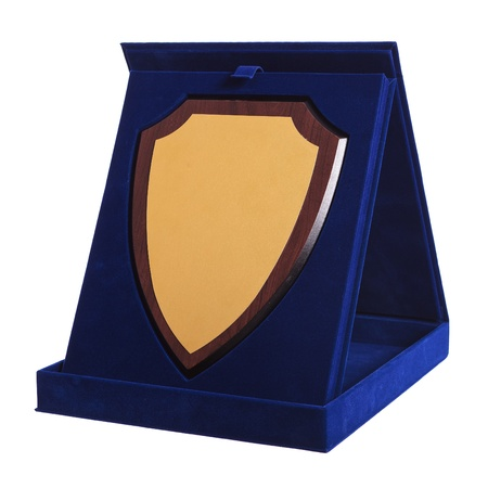blue plaque: shield shaped trophy in a blue award box on white background Stock Photo