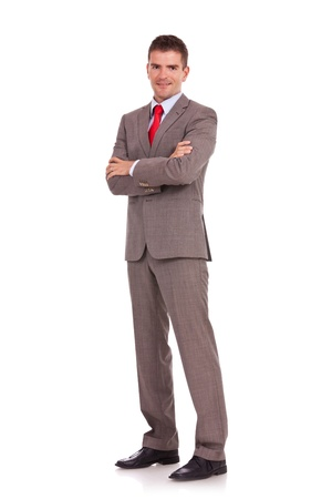 folded hands: Full length of young business man standing with arms folded isolated on white background Stock Photo