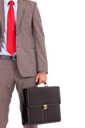 detail of a business man's suit and tie with briefcase. cutout picture of a business man holding a briefcase, isolated on white Stock Photo - 16193519