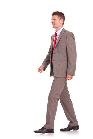 side by side: picture of a young business man walking forward - side view