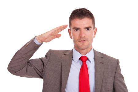 Salute: Business man giving military salute isolated on white background  Stock Photo