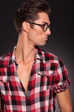 confused casual man looking to his left side on black background Stock Photo - 16334097
