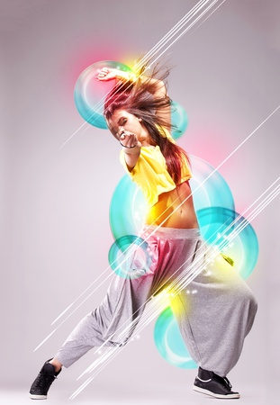 cool girl: passionate young woman dancer in a beautiful dreamy pose on a colorful background Stock Photo