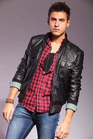 fashion model in casual clothes and leather jacket standing on gray background Stock Photo - 16479707