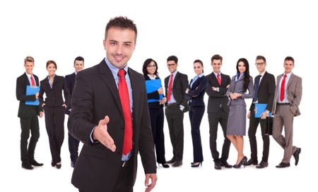 Isolated successful business team, focus on man with handshake gesture. young business man welcoming to the team Stock Photo - 17242301