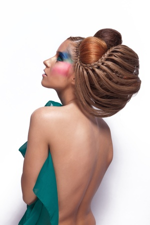 Fashionable photo of elegant girl with avangarde hairstyle and beautiful makeup Stock Photo - 17242303