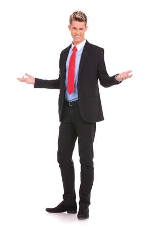 Happy businessman with arm out in a welcoming gesture , isolated on white background Stock Photo - 17242292