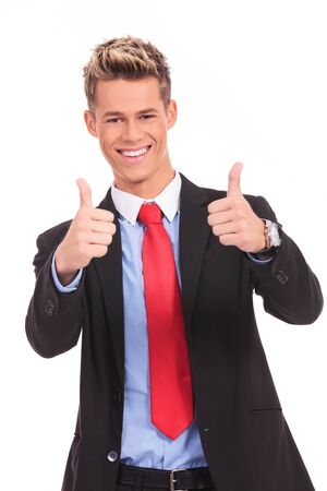 Happy businessman with thumbs up ok gesture, isolated on white  photo