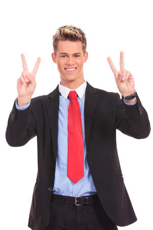 Happy smiling young business man showing two fingers or victory gesture, isolated over white background  Stock Photo - 17242353