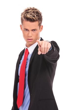 accusing: Authoritative, serious businessman pointing accusing finger