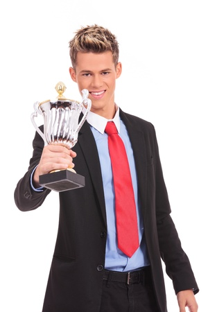 enthusiastic: Business man giving you a trophy cup with pride