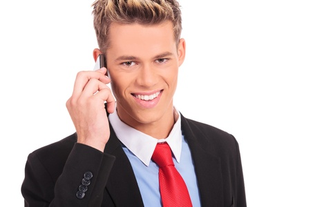 telephone salesman: Cool business man talking on mobile phone on white background