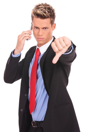 Business man with bad news on his cell phone disapproving . negative answer Stock Photo - 17242347