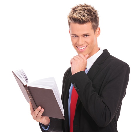 relaxed and pensive business man reading a book Stock Photo - 17242371